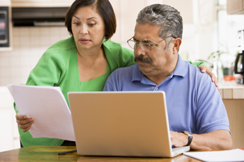couple-in-kitchen-with-laptop-and-paperwork--350x233.jpg